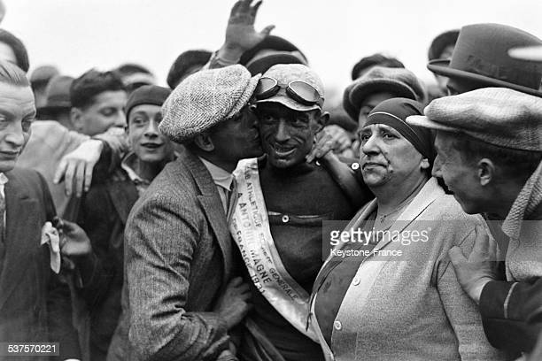 Antonin Magne winner of the Tour de France is congratulated by his brother on July 26 1931 in Paris France