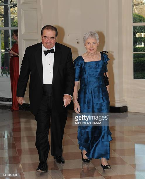 Antonin Scalia Associate Justice of the United States Supreme Court and Maureen M Scalia arrive for the State Dinner in honor of British Prime...