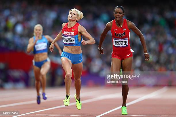 Antonina Krivoshapka of Russia and DeeDee Trotter of the United States compete in the Women's 400m Semi Final on Day 8 of the London 2012 Olympic...