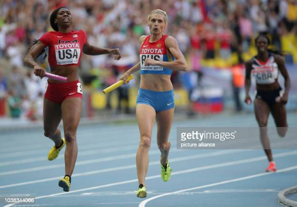 Antonina Krivoshapka of Russia and Francena McCorory of USA compete in the women's 4x400m relay final at the 14th IAAF World Championships in...