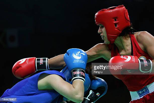 Antonina Shevchenko of Kyrgyzstan fights against Tomoko Kugimiya of Japan in the Women's 60kg preliminary match during the AIBA Women's World Boxing...