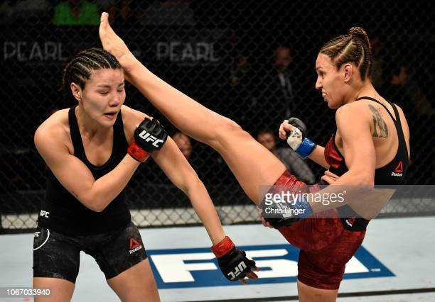 Antonina Shevchenko of Kyrgyzstan kicks Ji Yeon Kim of South Korea during The Ultimate Fighter Finale event inside The Pearl concert theater at Palms...