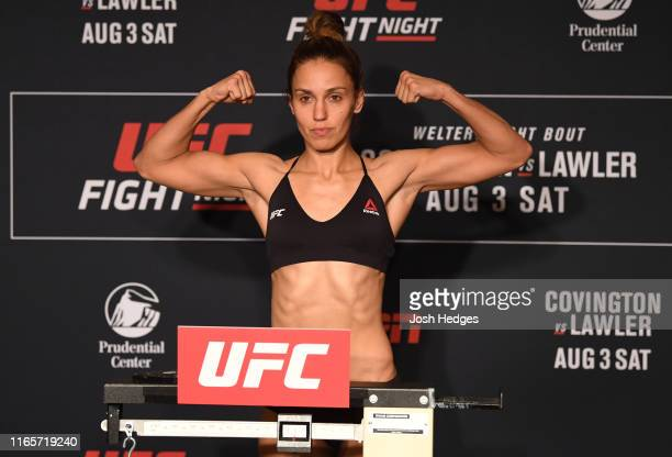 Antonina Shevchenko of Kyrgyzstan poses on the scale during the UFC Fight Night official weighin at the DoubleTree Hotel on August 02 2019 in Newark...