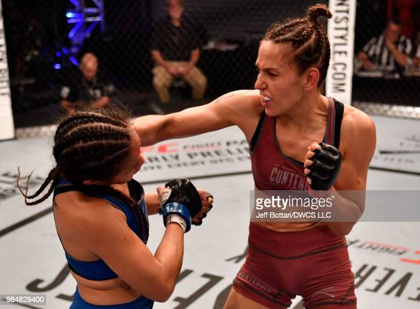 Antonina Shevchenko of Kyrgyzstan punches Jaimee Nievera in their women's flyweight bout during Dana White's Tuesday Night Contender Series at the...