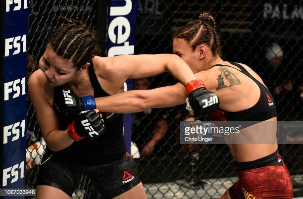 Antonina Shevchenko of Kyrgyzstan punches Ji Yeon Kim of South Korea during The Ultimate Fighter Finale event inside The Pearl concert theater at...