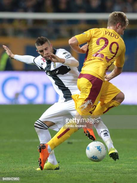 Antonino Barilla of Parma Calcio 1913 competes for the ball with Luca Vido of AS Cittadella during the serie B match between Parma Calcio and AS...