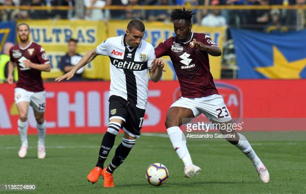 Antonino Barilla of Parma Calcio competes for the ball with Soualho Meitè of Torino FC during the Serie A match between Parma Calcio and Torino FC at...