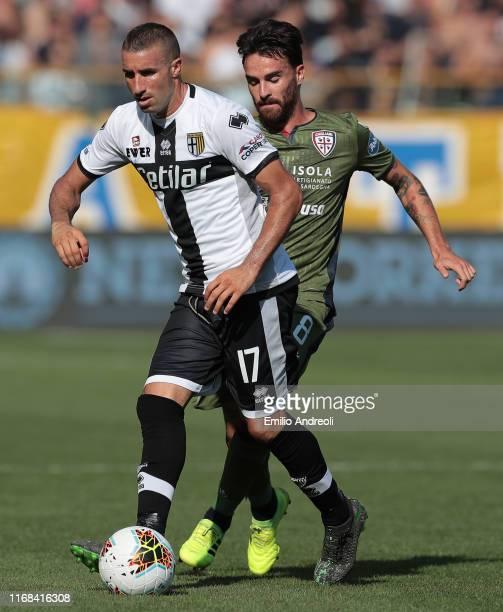 Antonino Barilla of Parma Calcio is challenged by Luca Cigarini of Cagliari Calcio during the Serie A match between Parma Calcio and Cagliari Calcio...