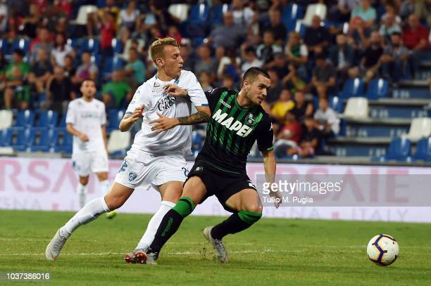 Antonino La Gumina of Empoli and Pol Lirola of Sassuolo compete for the ball during the serie A match between US Sassuolo and Empoli at Mapei Stadium...