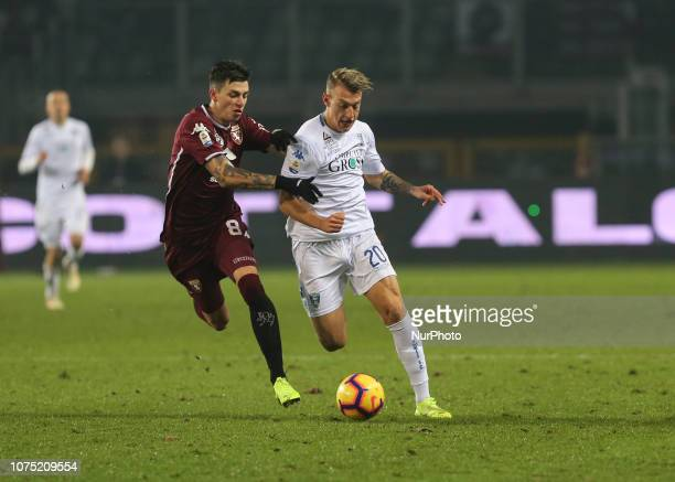 Antonino La Gumina of Empoli FC and Daniele Baselli of Torino FC competes for the ball during the Serie A football match between Torino FC and Empoli...