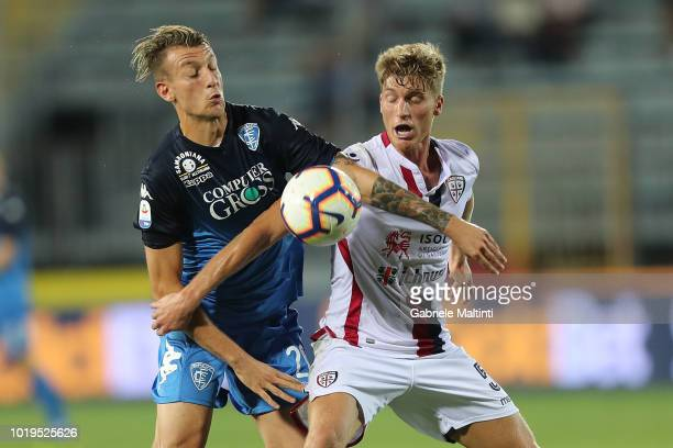 Antonino La Gumina of Empoli FC battles for the ball with Filippo Romagna of Cagliari during the serie A match between Empoli and Cagliari at Stadio...