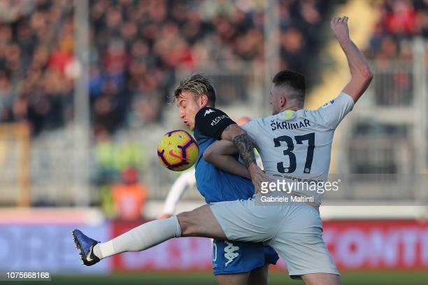 Antonino La Gumina of Empoli FC battles for the ball with Milan Skriniar of FC Internazionale during the Serie A match between Empoli and FC...
