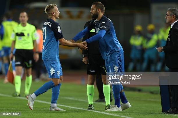 Antonino La Gumina of Empoli FC shakes hands hand with Levan Mchadlidze of Empoli FC during the serie A match between Empoli and AC Milan at Stadio...