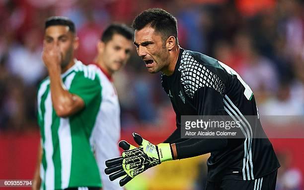 Antonio Adan of Real Betis Balompie reacts during the match between Sevilla FC vs Real Betis Balompie as part of La Liga at Estadio Ramon Sanchez...