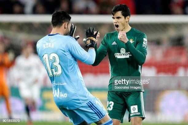 Antonio Adan of Real Betis celebrates 01 with Aissa Mandi of Real Betis during the La Liga Santander match between Sevilla v Real Betis Sevilla at...
