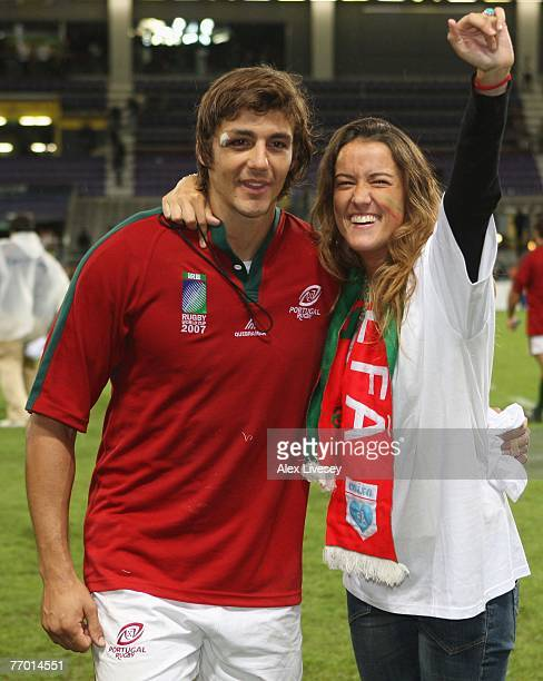 Antonio Aguilar of Portugal poses with his fiancee after she proposed to him after Match Thirty of the Rugby World Cup 2007 between Romania and...