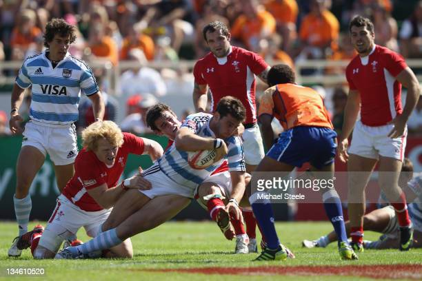 Antonio Ahualli de Chazal of Argentina scores a try despite the attention of Tom Habberfield and Richie Pugh of Wales during the Quarter Final match...