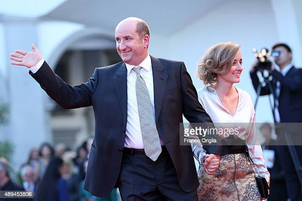 Antonio Albanese and Maria Maddalena Gnudi attend the closing ceremony and premiere of 'Lao Pao Er' during the 72nd Venice Film Festival on September...