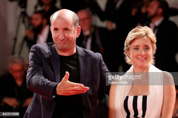 Antonio Albanese and Maria Maddalena Gnudi walk the red carpet ahead of the 'The Leisure Seeker ' screening during the 74th Venice Film Festival at...