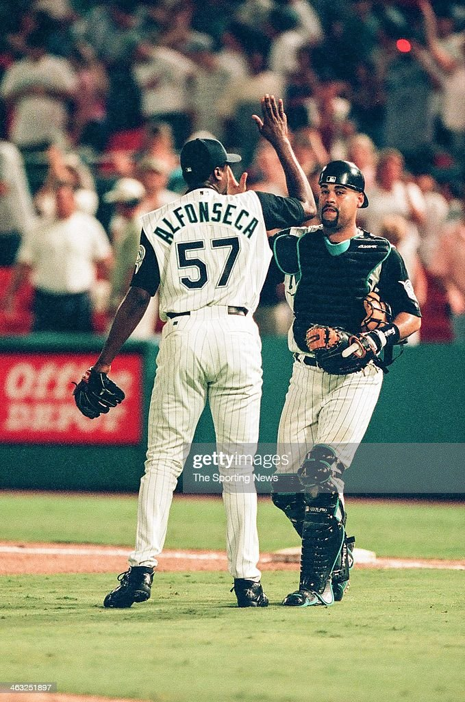 Antonio Alfonseca and Ramon Castro of the Florida Marlins high five during the game against the Arizona Diamondbacks on July 28, 2000 at Pro Player Stadium in Miami Gardens, Florida.