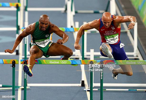Antonio Alkana of South Africa and Petr Svoboda of the Czech Republic compete during the Men's 110m Hurdles Semifinals on Day 11 of the Rio 2016...