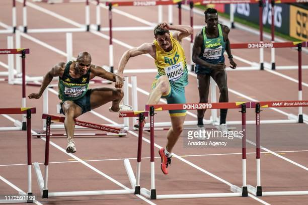 Antonio Alkana of South Africa Nicholas Hough of Australia and Gabriel Constantino of Brazil compete in the Men's 110 metres hurdles heats during day...