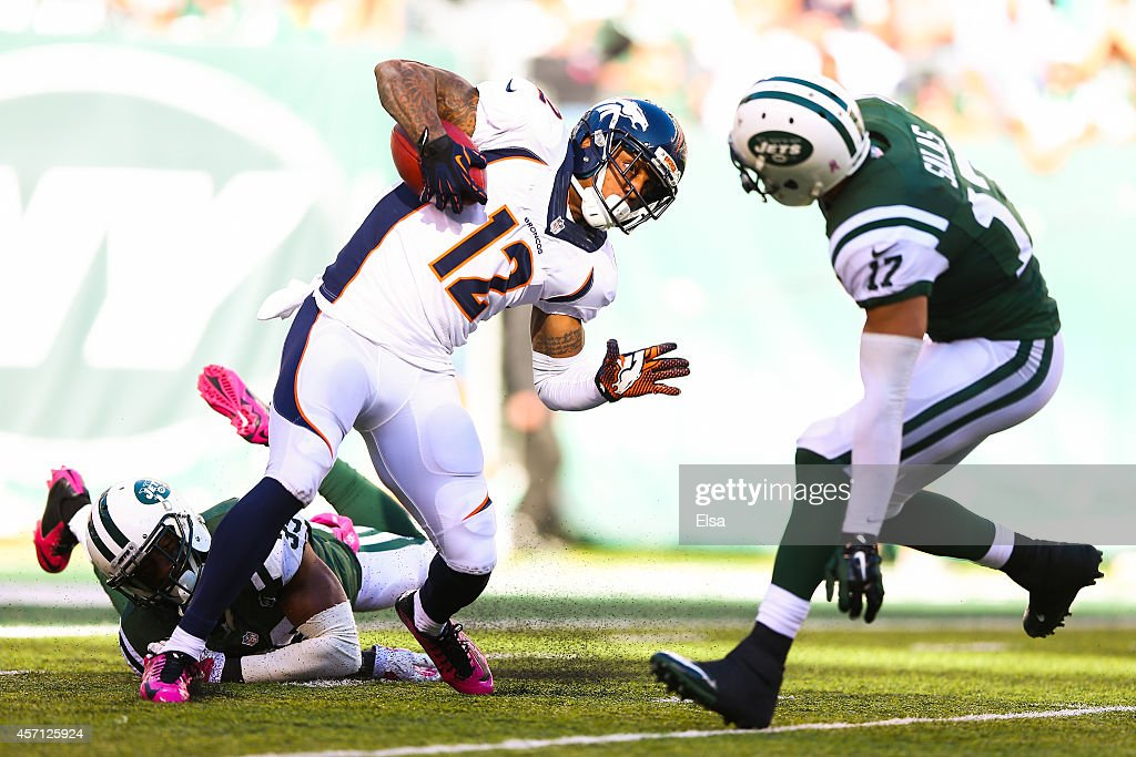 Antonio Allen #39 and Greg Salas #17 of the New York Jets attempt to tackle Andre Caldwell #12 of the Denver Broncos in the fourth quarter during a game at MetLife Stadium on October 12, 2014 in East Rutherford, New Jersey.