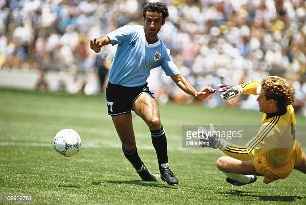 Antonio Alzamendi of Uruguay and Harald Schumacher of West Germany during the 1986 FIFA World Cup Finals Group E match on 4th June 1986 at the La...