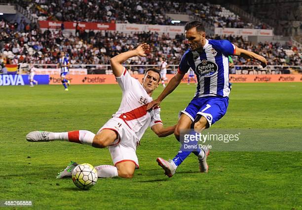 Antonio Amaya of Rayo Vallecano tries to tackle Lucas Perez of RC Deportivo la Coruna during the La Liga match between Rayo Vallecano and RC...