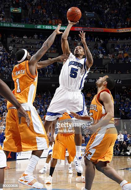 Antonio Anderson of the Memphis Tigers shoots over Tyler Smith of the Tennessee Volunteers at FedExForum on February 23 2008 in Memphis Tennessee...