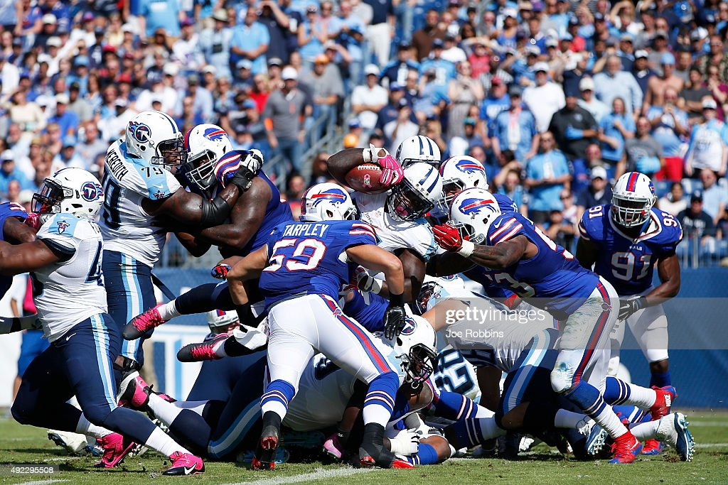 Antonio Andrews #26 of the Tennessee Titans dives into the end zone for a one-yard touchdown in the third quarter of the game against the Buffalo Bills at Nissan Stadium on October 11, 2015 in Nashville, Tennessee. The Bills defeated the Titans 14-13.