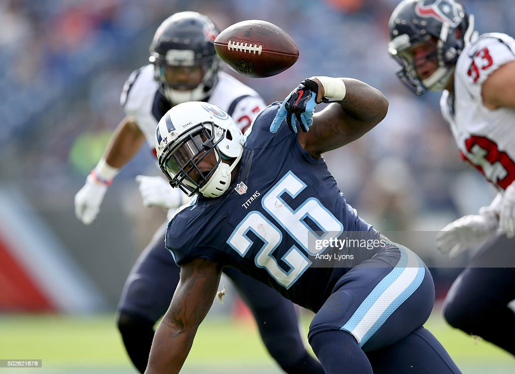 Antonio Andrews #26 of the Tennessee Titans fumbles the ball during the first quarter against the Houston Texans at LP Field on December 27, 2015 in Nashville, Tennessee.