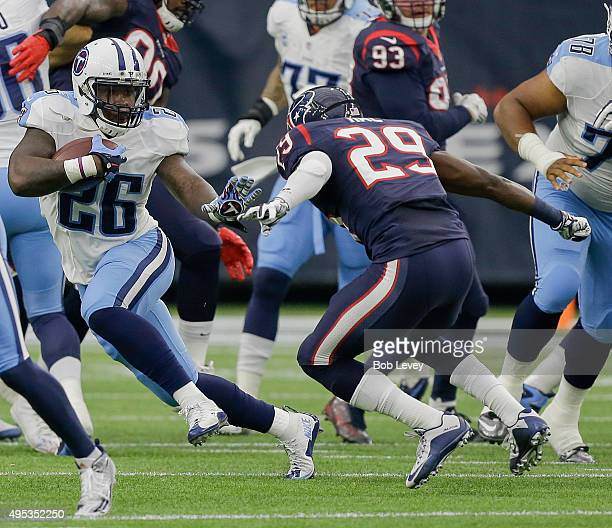 Antonio Andrews of the Tennessee Titans rushes to avoid a tackle attempt by Andre Hal of the Houston Texans during game action at NRG Stadium on...
