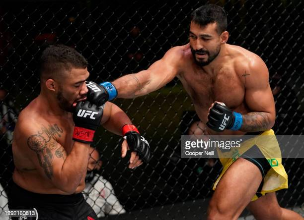 Antonio Arroyo of Brazil punches Deron Winn in a middleweight fight during the UFC Fight Night event at UFC APEX on December 19, 2020 in Las Vegas,...