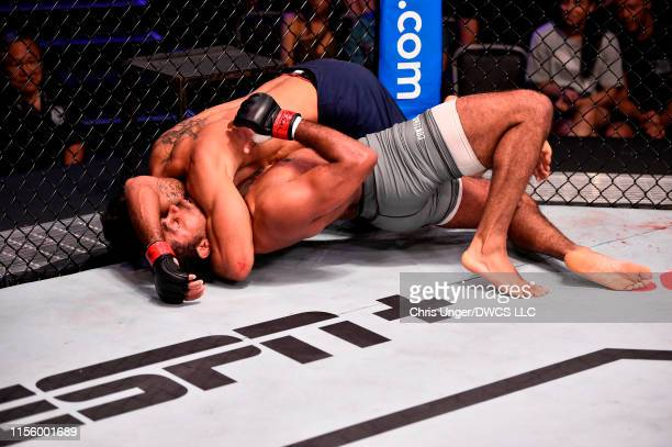 Antonio Arroyo of Brazil submits Stephen Regman in their middleweight bout during Dana White's Contender Series at the UFC Apex on July 16 2019 in...