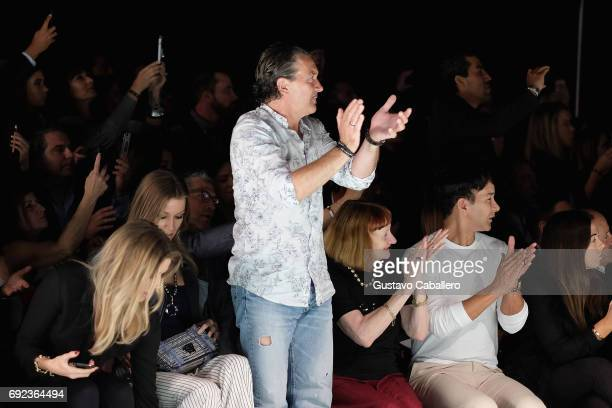 Antonio Banderas and Designer Rene Ruiz are seen front row at the Angel Sanchez Show during Miami Fashion Week at Ice Palace Film Studios on June 4...
