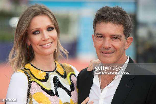 Antonio Banderas and his companion Nicole Kimpel arrive for the screening of 'The Music of Silence' during the 43rd Deauville American Film Festival...