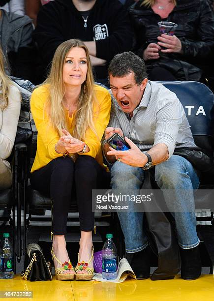 Antonio Banderas and Nicole Kimpel attend a basketball game between the Milwaukee Bucks and the Los Angeles Lakers at Staples Center on February 27...