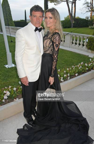 Antonio Banderas and Nicole Kimpel attend the amfAR Cannes Gala 2019 at Hotel du Cap-Eden-Roc on May 23, 2019 in Cap d'Antibes, France.