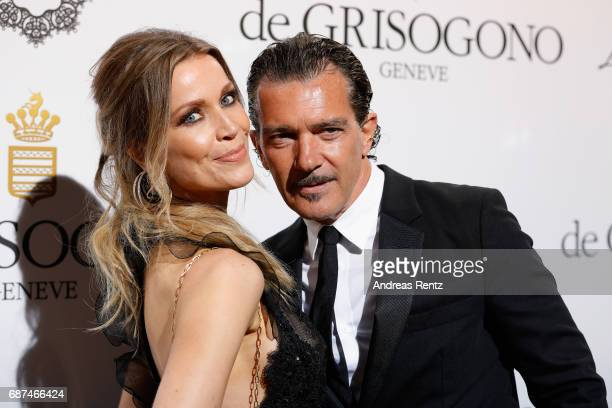 Antonio Banderas and Nicole Kimpel attend the DeGrisogono 'Love On The Rocks' during the 70th annual Cannes Film Festival at Hotel du CapEdenRoc on...