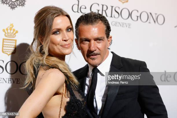 Antonio Banderas and Nicole Kimpel attends the DeGrisogono 'Love On The Rocks' during the 70th annual Cannes Film Festival at Hotel du CapEdenRoc on...