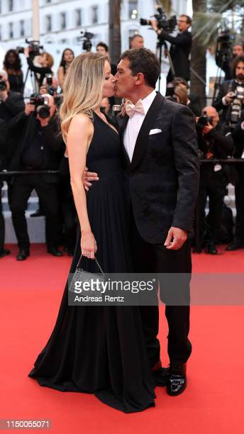 "Antonio Banderas and Nicole Kimpel kiss prior to the screening of ""Pain And Glory "" during the 72nd annual Cannes Film Festival on May 17, 2019 in..."