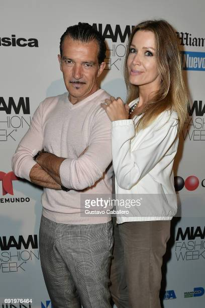Antonio Banderas and Nicole Kimpel pose backstage at the Fisico Show during Miami Fashion Week at Ice Palace Film Studios on June 3 2017 in Miami...
