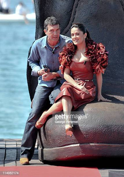 """Antonio Banderas and Salma Hayek attend the """"Puss In Boots"""" Photocall at Carlton Beach during the 64th Cannes Film Festival on May 11, 2011 in..."""