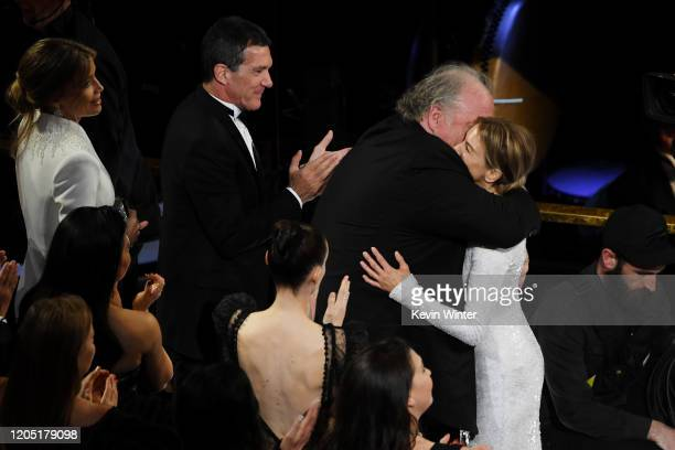 Antonio Banderas John Carrabino and Renée Zellweger react after Ms Zellweger was named winner of the the Actress in a Leading Role award for 'Judy'...