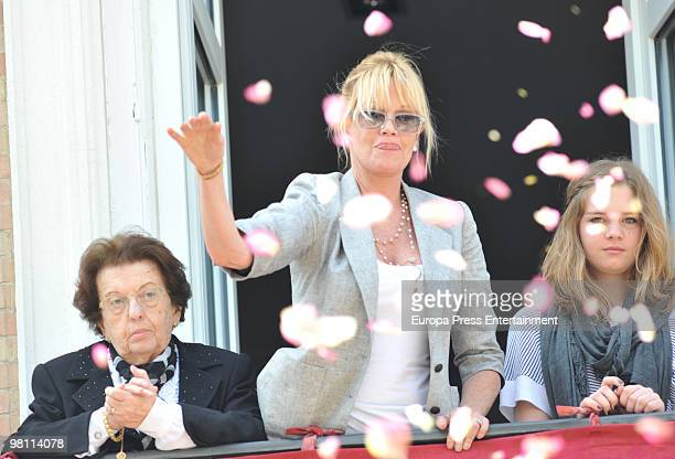 Antonio Banderas takes part in an Easter Procession while his mother Ana Banderas his wife Melanie Griffith and his daughter Stella follow it from a...