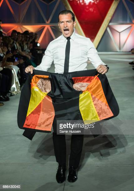 Antonio Banderas walks the runway at the Fashion for Relief event during the 70th annual Cannes Film Festival at Aeroport Cannes Mandelieu on May 21...