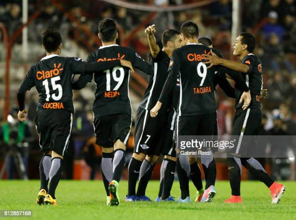 Antonio Bareiro of Libertad celebrates with teammates Oscar Cardozo Angel Cardozo Lucena Jesus Medina and Alan Benitez after scoring the fourth goal...
