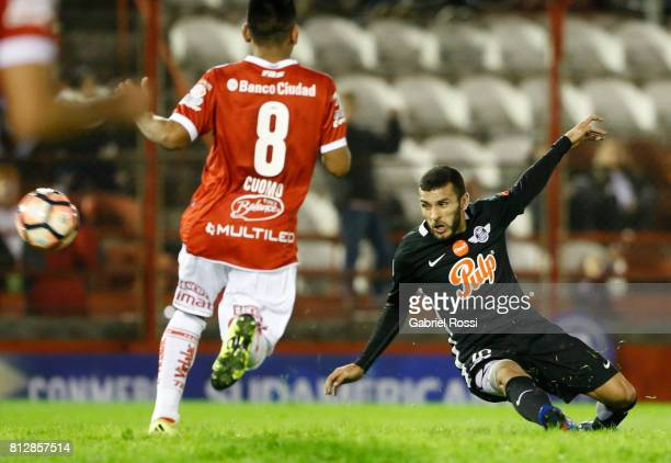 Antonio Bareiro of Libertad kicks the ball to score the fourth goal of his team during a first leg match between Huracan and Libertad as part of...