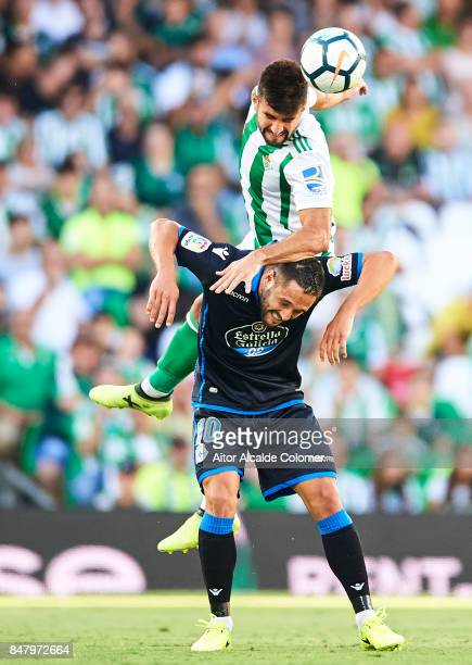Antonio Barragan of Real Betis Balompie competes for the ball with Florin Andone of RC Deportivo during the La Liga match between Real Betis and...